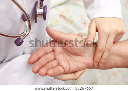 Nurse checking patient's blood pressure - stock photo
