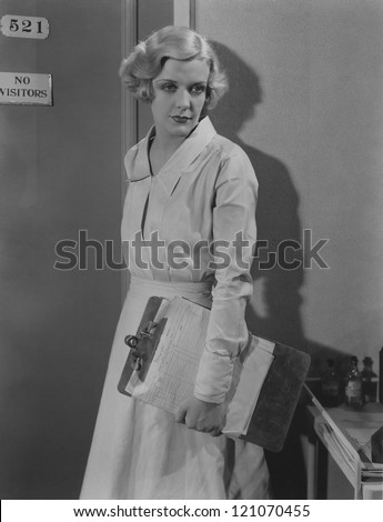 Nurse does her rounds - stock photo