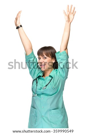 Nurse excited. Happy cheerful woman nurse or young doctor with arms up. Isolated on white background. Young caucasian female medical professional. - stock photo
