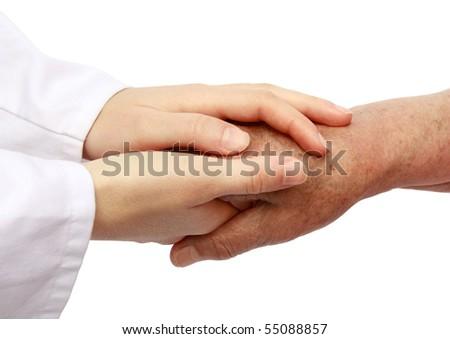 Nurse helping senior in hospital - stock photo