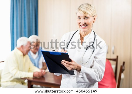 Nurse holding a clipboard in a retirement home