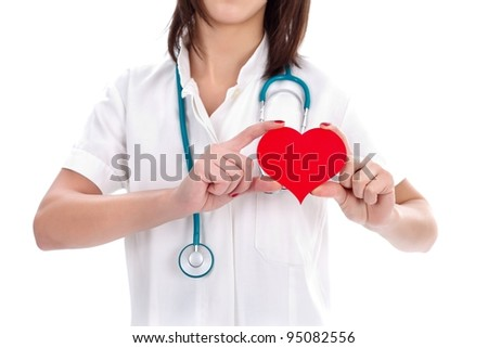 Nurse holding a red paper heart showing the place of it