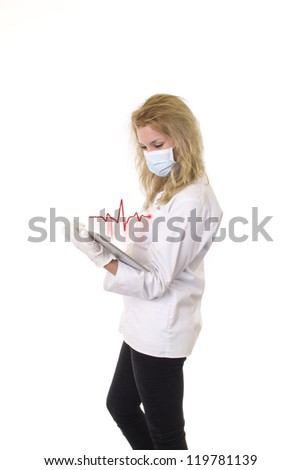 Nurse holding tablet with pulse on blank white screen - stock photo