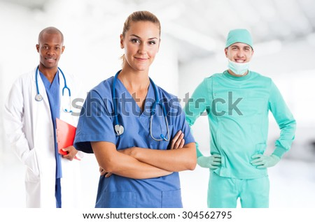 Nurse in front of her medical team - stock photo