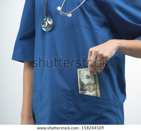 Nurse in uniform with a stethoscope. Pulls money out of pocket. On a gray background