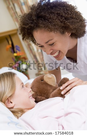 Nurse Laughing With Her Young Patient - stock photo