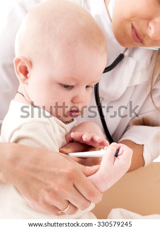Nurse measures the temperature of a baby, isolated on white background. Health care concept.
