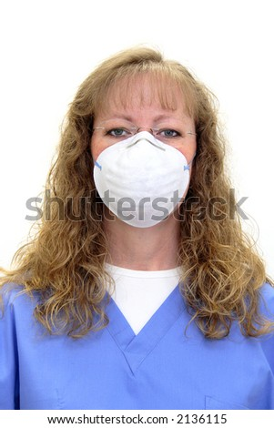 Nurse or dental hygienist in scrubs wearing a protective mask and eye glasses. Isolated on white. - stock photo