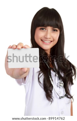 Nurse or young medical doctor woman showing business card isolated on white background - stock photo