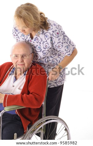 nurse pushing elderly man in wheelchair - stock photo