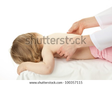 Nurse's hands massaging back of a little child on white background