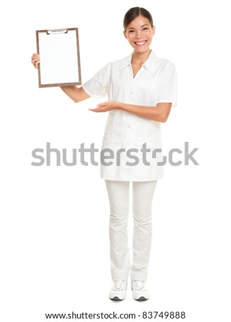 Nurse showing blank clipboard sign - a medical concept. Woman doctor / nurse smiling happy isolated on white background in full body. Mixed race Caucasian / Chinese Asian female model. - stock photo