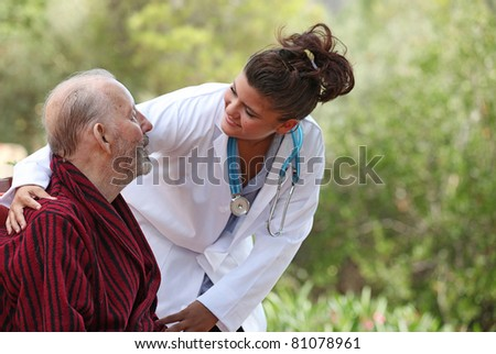 nurse showing care to patient - stock photo