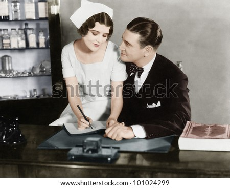 Nurse sitting on the doctor's lap - stock photo