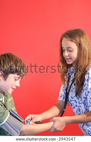 nurse student checking blood pressure vertical - stock photo