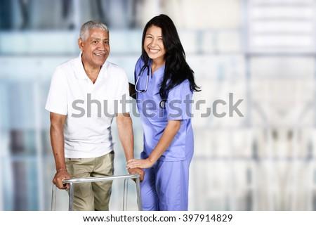 Nurse taking care of an elderly patient - stock photo