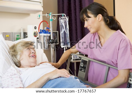Nurse Talking To Senior Woman - stock photo