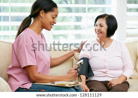Nurse Visiting Senior Female Patient At Home - stock photo