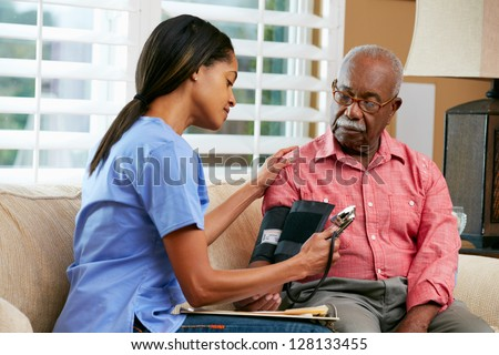 Nurse Visiting Senior Male Patient At Home - stock photo