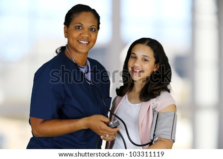 Nurse with a patient in the hospital