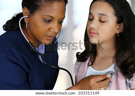 Nurse with a patient in the hospital - stock photo