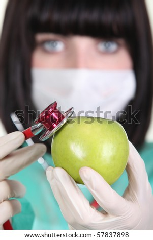 Nurse with a stethoscope and an apple