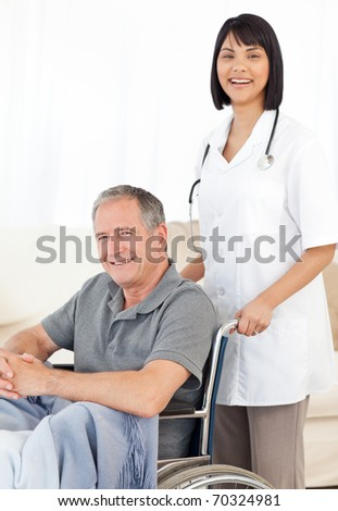 Nurse with her patient looking at the camera - stock photo