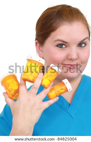 Nurse with pills - stock photo