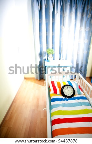 nursery room await born of child with clock represents 9 month term - stock photo