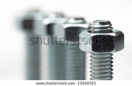 Nut and bolt close up with shallow Dof - stock photo