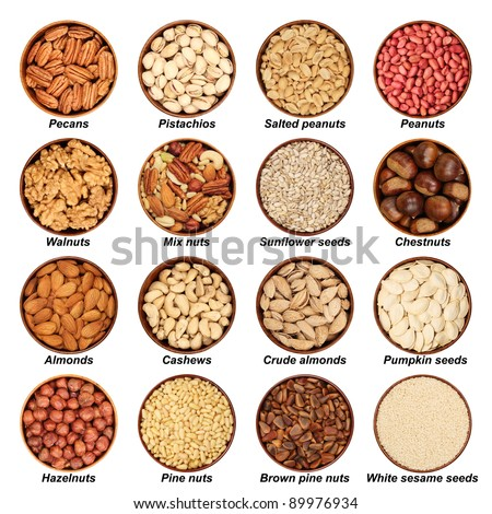 Nut mix - hazelnuts, peeled almonds, walnuts, pecans, pine nuts, cashews, nut mix, pistachios, seeds, pumpkin seeds, chestnuts, peanuts, sesame seeds, wooden bowls, isolated, goober, background white - stock photo