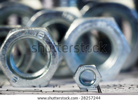 nut over big nuts,shallow dof - stock photo