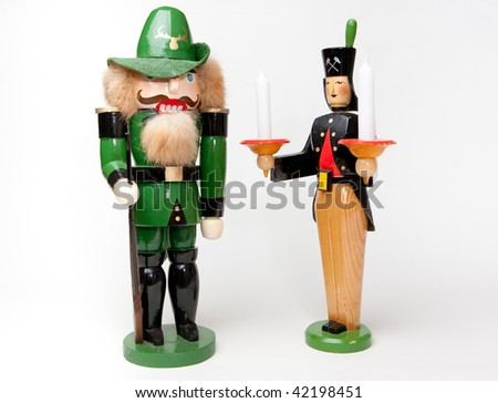 nutcracker and wooden character with candles