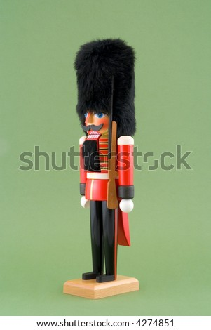 Nutcracker Soldier Isolated on Green - stock photo