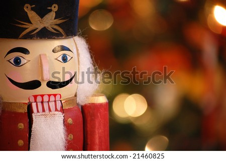 Nutcracker with holiday lighting background