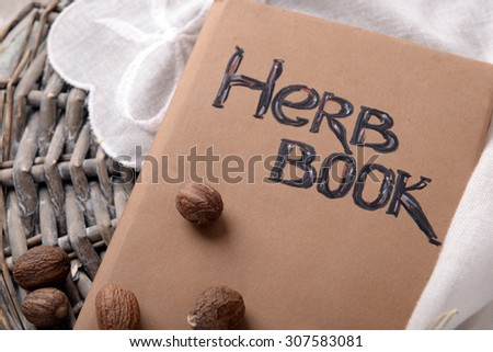 Nutmeg and book on table close up - stock photo