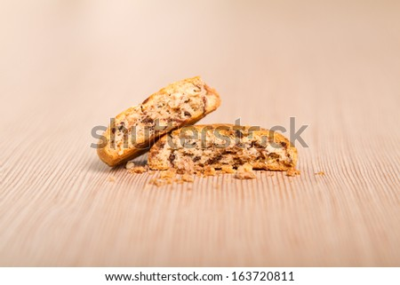 Nutmeg cookie broken in two - stock photo
