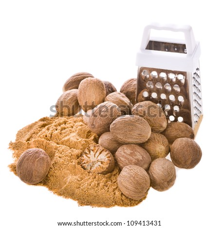 Nutmeg, grated stainless steel, half nuts and whole nutmeg is isolated on a white background. - stock photo