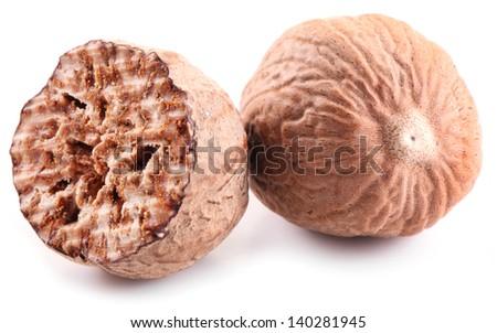 Nutmeg on a white background. - stock photo