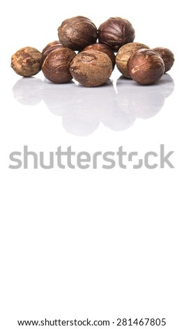 Nutmeg over white background