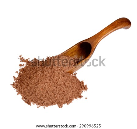 Nutmeg powder in the wooden spoon, isolated on white background. - stock photo