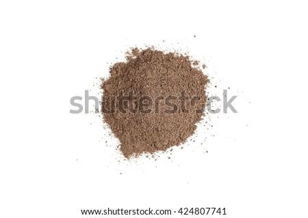 Nutmeg powder (Myristica fragrans) isolated on white background - stock photo