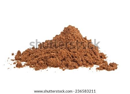 Nutmeg powder on a white background - stock photo