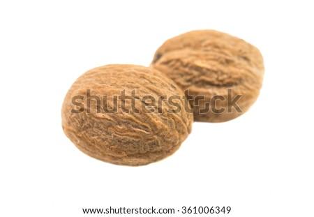 nutmeg spice on a white background - stock photo