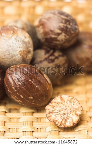 Nutmegs in stack, very shallow dof, focus on the grated one. - stock photo