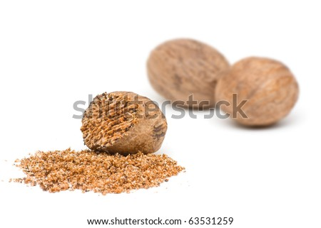 Nutmegs whole and grind over white background - stock photo