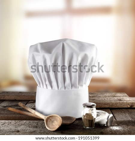nutrition and cook hat on desk  - stock photo