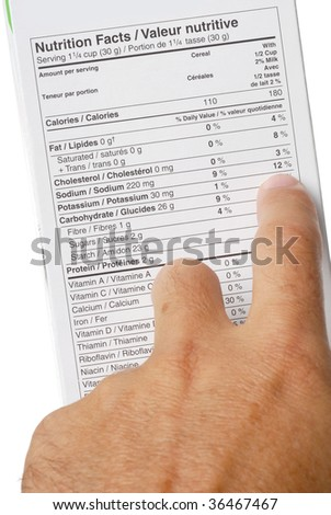 Nutrition fact label and hand pointing at 12 percent sodium - stock photo