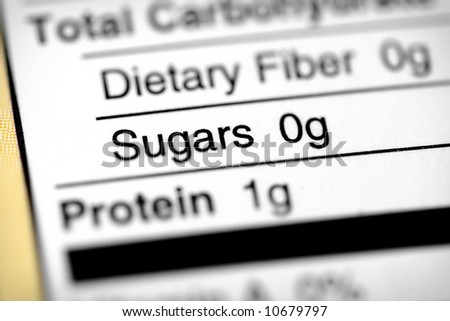 Nutritional label with focus on sugars. - stock photo