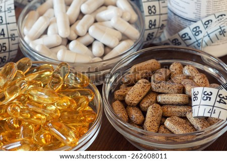 Nutritional supplements in capsules and tablets. Selective focus, shallow DOF - stock photo